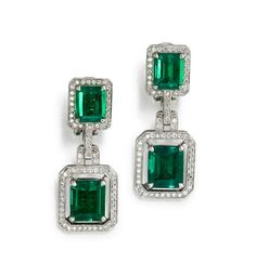A pair of emerald and diamond pendant earrings, William Goldberg, each surmount set with rectangular emerald-cut emeralds, weighing a total of 4.14 carats, pavé-set with round brilliant-cut diamonds, suspending an articulated link to a round brilliant-cut pavé-set frame, centering rectangular emerald-cut emeralds, weighing a total of 7.31 carats.