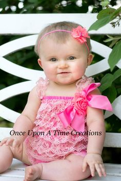 Bright Pink Romper  Gorgeous bright pink lace petti romper, embellished with a matching shabby flower. Sure to be an eye catcher!  All rompers