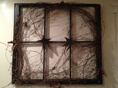 Use the window frame from 3x great grandparents homestead....place framed pictures of the home them and now....DCN