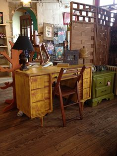 Heavily distressed desk done in American Paint Company A-Maize-Ing over Fireworks Red.