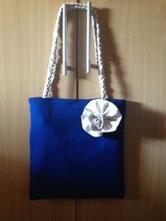 Blue canvas bag with faux leather flower
