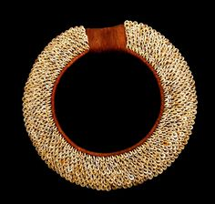 Papua New Guinea | Shell currency Necklace. Beautiful hand woven shell currency necklace made up of hundreds of Nassa shells. Piece is modern |  Shell currency is no longer used in Papua New Guinea but the heritage is still present in local customs. They have a high monetary value and proclaim the chiefs' economic power. Shell currency jewelry such as these are also used as bride price in wedding ceremonies. | 1000$ ~ Sold