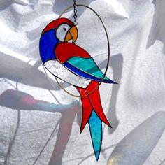 Stained Glass Parrot in a ring Suncatcher Mobile. $39.95, via Etsy.