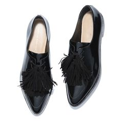 Loeffler Randall's spin on the classic menswear loafer is rife with feminine details: done in a polished calfskin leather, it has a sharply pointed toe and finished with a cluster of suede tassels. Basically, it's a no-fail option that goes from work to drinks (to dancing) seamlessly.
