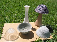Concrete Mushroom This type was made over a glass bowl (covered in plastic wrap), with the concrete over it. The stem is a bud vase with the concrete mix over it. These are my new favorite stem, and the easiest! And the bud vases come in some very cute shapes.