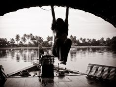 hanging from a boat in the kerala backwaters
