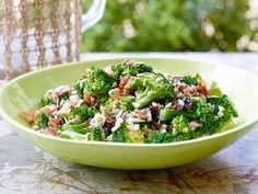 Broccoli Salad : Trisha's potluck-ready salad packs solid punches in both the flavor and texture departments, from the crispy, salty bacon and chewy raisins to the crunchy sunflower kernels, vibrant broccoli and creamy mayonnaise-based dressing.