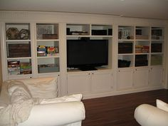 need built in wall entertainment center with storage boxes