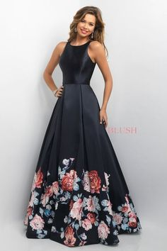 Polished A-line gown that features a classic jewel neckline and an open keyhole back. This beauty is complete with a pleated satin skirt printed in a floral pattern and gently adorned with AB crystals. Back zipper closure.