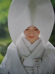 "Wedding in Kyoto Japan. This hat called ""Tsuno kakushi"", means horn hiding."