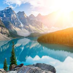 Sunset over Moraine Lake, Canada  #glooby  Moraine Lake is one of the most famous beautiful lakes in the world. Rock particles in the glacial waters cause the lake to take an amazing powder blue color.  Moraine Lake is a great example of a beautiful destination worth preserving on our world.  Double tap if you agree!