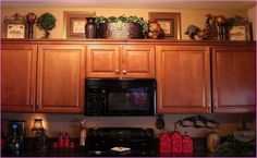 decorate chelf above cabinets | You could also incorporate the practical with the attractive and add ...