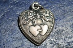 Antique Victorian Sterling Silver Repousse Puffy Heart Charm for a Bracelet.