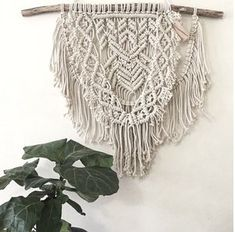 This Macrame wall hanging is made-to-order by Hanifah in Sydney, Australia. Each macrame is a unique and exclusive piece as the drift wood is different in shape and colour to any other piece. It is a perfect wall-hanging to turn your living room, dining room or bedroom into a cosy space.  Measurements: Length 95cm Height 77cm