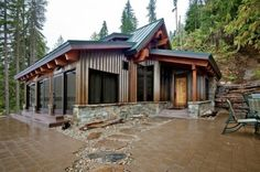 Cabin Exterior - weathered steel and stone