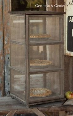 An Early century Screened Screen Pie Safe. from Gershwin & Gertie - purveyors of fine farmhouse vintage kitchen, bath and housewares, as well as rural style reproductions of reclaimed antique wood. Ode to a Simpler Life