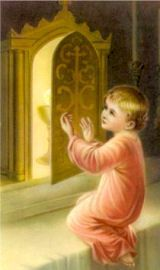 Divine Child Jesus next to the Tabernacle.