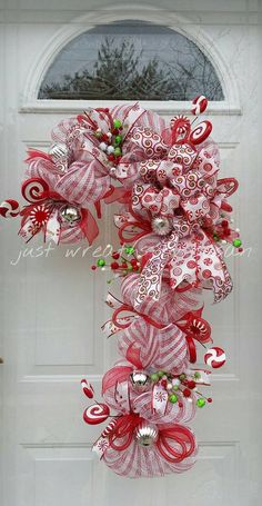 Your place to buy and sell all things handmade Candy Cane Wreath Candy Cane Deco Mesh by justwreathsbysusan Deco Mesh Crafts, Wreath Crafts, Diy Wreath, Christmas Crafts, Wreath Ideas, Christmas Parties, Candy Cane Wreath, Candy Canes, Christmas Mesh Wreaths