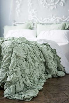 Love the pale green comforter. Hate the pale blue walls. Looks like the inside of an ice cave. Brrrrr. . . . .