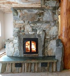 Stone masonry heater with a heatkit.com core.