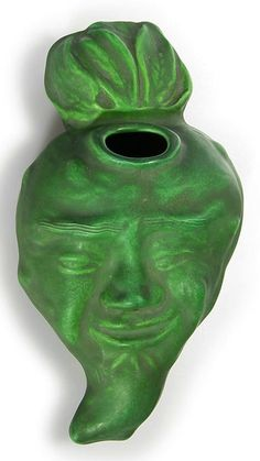 """Owens """"Turnip Man"""" wall pocket, covered in a matte green glaze. Impressed """"OWENSART"""" in block letters on the back. Size is 11 inches long by 6 inches wide and 3 3/4 inches deep."""