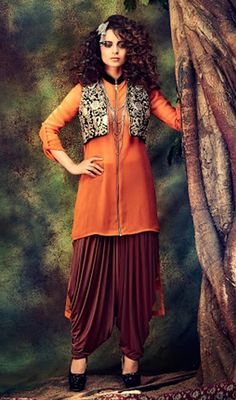 Get ingenious and stylish at the same time just like Kangana Ranaut draped in this orange embroidered georgette patiala suit. The wonderful dress creates a dramatic canvas with terrific butta and resham work. #NewZipperFashionOfPatiyalaSuit