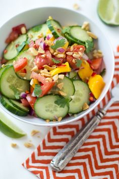 East African Mango & Cucumber Salad - so easy to make and FULL of big flavors. Perfect salad to bring to a party! Raw Food Recipes, Salad Recipes, Vegetarian Recipes, Cooking Recipes, Healthy Recipes, Fun Recipes, Mango Salad, Cucumber Salad, Detox Salad