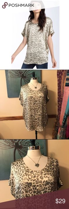 Joie JoAnn C Animal Print Silk Tunic Top Size XS. A dark animal print covers a smooth, satiny tunic styled with an oversized shape & a curved hemline. 100% silk. EUC Joie Tops Blouses