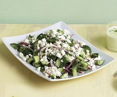 Cucumber & Herb Salad with Crumbled Feta ~  This simplified spin on a classic Greek salad omits the tomatoes and olives and lets the cucumbers carry the bright flavor of fresh herbs, red wine vinegar, and savory feta.