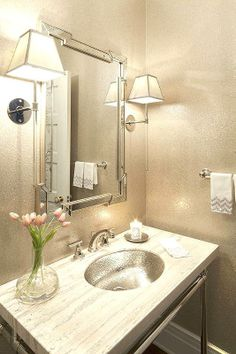"""Whether it's in a powder room or a master bathroom, most of us want to be able to see ourselves clearly in the mirror in order to apply makeup, shave, etc. To avoid unwanted shadows, considering installing task lighting such as sconces or pendants on each side of the mirror that are at least 28"""" apart and 60"""" from the floor."""