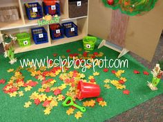 love this preschool center with the fake Velcro apples to the tree AND add real leaves to your dramatic play area along with a child sized wheelbarrel and rake!