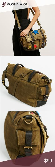 "BRAND NEW Free People Messenger Bag Style: 39765326   Military-inspired canvas messenger bag adorned with a variety of patches and pins making each bag one-of-a-kind. Leather trim and strap closures. Zip top with a lined interior featuring zip and slip closures. Removable and adjustable long strap.  Canvas Leather Import Product measurements Width: 14"" = 35.56 cm Height: 9.5"" = 24.13 cm Depth: 4"" = 10.16 cm Free People Bags Crossbody Bags"