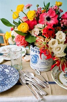summer tablescape...mixed colors in a can with a label...