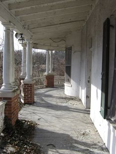 Abandoned Mansion and Guest House showing the porch - I so wish I could buy this house and restore it.