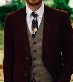 There's no better time to adopt the wool suit trend than for a fall wedding. A wool groom's suit - like the mahogany wool suit shown here - will keep him a bit warmer than a traditional tuxedo and the texture is ideal for a rustic, nature-filled wedding photo shoot. Pair with a floral tie for an extra touch of whimsy.
