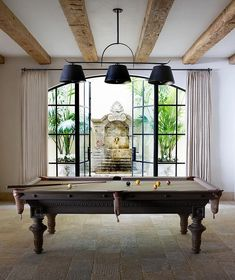 Beautiful Billiards room with stone floor, beamed ceiling and arched window with french Pleat drapes . love the light neutrals, simplicity and airiness of the room. Living Area, Living Spaces, Billards Room, Provence, Interior Decorating, Interior Design, Stone Flooring, Windows And Doors, Decoration