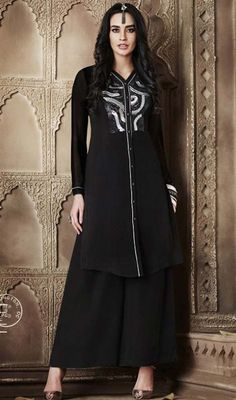 Attract the spotlight among the crowd owning this black color embroidered georgette kurti. Beautified with resham and lace work. #sexylooktunics #straightlongtunics #blackcolorkurtis