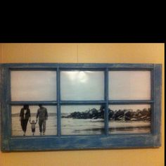Repurposed window pane. i like using a large photo instead of several small ones in each pane.