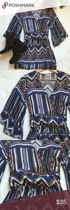 "{Olivaceous} Boho Bell Sleeve Mini Dress So cute! Mini dress with faux wrap style deep V neck. 3/4 length bell sleeves and drawstring at waist. Approx 34"" shoulder to bottom of hem. 100% rayon. Colors: cream, black, blue, and burgundy. Excellent condition. Olivaceous Dresses Mini"