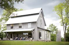 Lovely grey house with shutters painted the same  4-belk-farmhouse-gardenandgun-Snippet & Ink-Design Crush