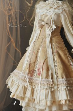 Cute, classic lolita (hanbok inspired): Creme dress with white details and lace.