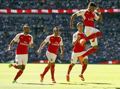 Arsenal beat Chelsea 1-0 in the Community Shield at Wembley, Alex Oxlade-Chamberlain leaps to celebrate scoring the only goal.