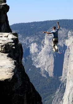 Man highlining at Taft Point in Yosemite National Park with El Capitan in the background.  http://www.visiontimes.com/2015/03/26/watch-the-legend-walk-a-slackline-between-two-hot-air-balloons-and-find-out-why.html