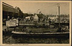 1940's. View on the Ruijterkade and Het IJ in Amsterdam. In the background on the left Centraal Station; in the center the passenger house of the ferry to Amsterdam-Noord. #amsterdam #1940 #Ruijterkade #HetIJ