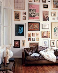 really great mix of art and photos on this galleryw all. also, love the brown leather couch and white throw
