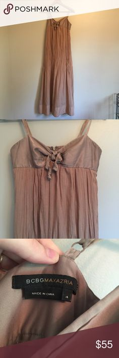 BCBGMaxAzria Maxi Dress This dress is so much prettier than what the pictures give it credit for. The cloth is just wrinkled from storage. It has subtle rose gold colored stripes running down the dress. BCBGMaxAzria Dresses Maxi