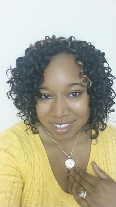 Crochet Braids using FreeTress' Presto Curl. Cut the hair in half before installing for a short, flirty look. It layers in nicely and feels super light without the extra cutting at the end!