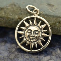 A personal favorite from my Etsy shop https://www.etsy.com/listing/449646450/sterling-smiling-sun-charm-light-life