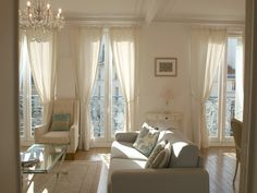 Serene white shabby chic living room/Nordic French apartment in Paris we rented/Hello Lovely Studio/