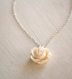 Rose necklace from Two Little Doves (one of my favorite shops on Etsy)... $23.50